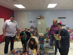 Helping to organize the gifts in the Project T.O.Y. warehouse