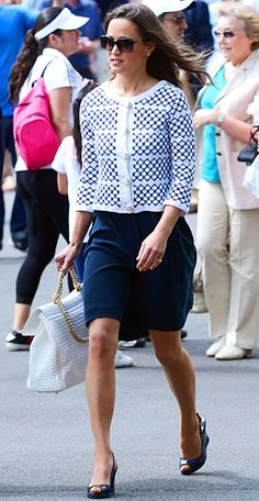 The royal-in-law took in a Wimbledon tennis match wearing a navy dress and macramé jacket by Irish designer Orla Kiely. She paired the look with a quilted white bag and patent leather wedges.