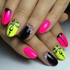Elegant neon nail art with crystals and fleur-de-lis