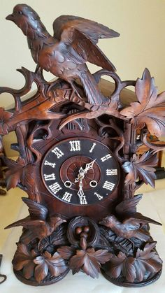 Unusual Cuckoo Clocks antique cuckoo clock old rare beautiful carving. runs 1800′s