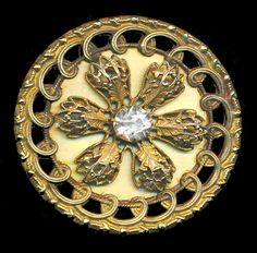 Late 19th c. brass button with ivoroid celluloid and clear paste center stone.