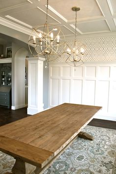 I love the farmhouse table with the double light fixtures and the board and batten walls...perfection!