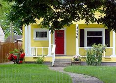 Yellow house with red door.