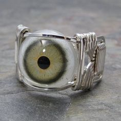 Green Glass Eye Eyeball Sterling Silver Wire Wrapped Ring ANY size. $30.00, via Etsy.