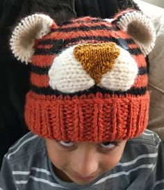 Free Knitting Pattern for Tiger Hat for Baby through Adult - Hat in sizes from baby to adult, knit in the round with some sewing to attach face features. Sizes 6 to 24 months, 2 to 6, 7 to 11, Adult. Designed by Barb Padwicki. Pictured project by maigret