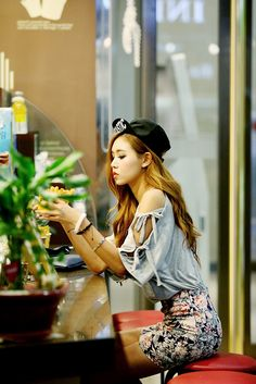 Cutout top, floral print skirt and black cap - Korean street fashion staples.  -Lily #koreanfashion