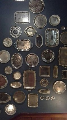 Old silver plated trays on a wall                                                                                                                                                     More