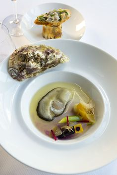 Oxtail and conger bouillon with wasabi, roasted marrow bone, stewed vegetables and poached oysters.