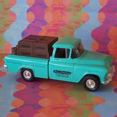 Ertl 1955 Chevy Cameo Pickup Truck Classic Motorbooks Die cast Bank. $27.95, via Etsy.