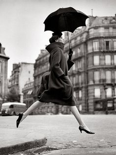 the coat...the shoes...the umbrella....the city...beautiful.