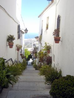 Mijas - Callejon de los Gitanos - photo by Robert Bovington ***   I like walking the steep narrow streets and admiring the little houses with their white facades adorned by colourful pots of flowers.