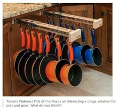 This is an amazing way to organize your pots and pans, and to keep them from ban... - http://centophobe.com/this-is-an-amazing-way-to-organize-your-pots-and-pans-and-to-keep-them-from-ban-2/ -