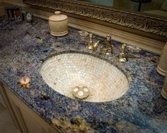 Beautiful mother of pearl basin sink set in a gorgeous Brazilian Azul Bahía granite countertop. Milk and Honey Design.