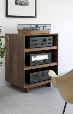 With adjustable solid wood shelves and a removable back panel with cutouts for wire management, the AERO Audio Rack is premium custom media furniture. Audio Rack, Lp Regal, Audio Stand, Hifi Stand, Audio Box, Stereo Cabinet, Record Cabinet, Rack Tv, Design Industrial