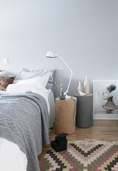 Grey and white bedroom. Lovely log side tables. Two tables per side...great.  Find similar at www.thelogbasket.co.uk