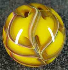Twisted cane marble  http://www.etsy.com/listing/87528218/mad-man-marbles-78-multi-color-twisted