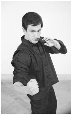 "Bruce Lee ""Demonstrates Vertical Hook Punch To The Rib-Cage."""