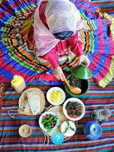 Gilaki Girl in her beautiful colorful Dress and traditional Cuisine from the Gilan Province, Iran.