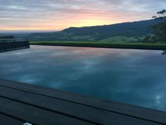Here are some infinity pool prices, ideas, and FAQs to help you decide if this is the right pool design for you #swimmingpools #ingroundpool #vanishingedge Infinity Pool Cost, Infinity Edge Pool, Fiberglass Pool Manufacturers, Overflow Pool, Automatic Pool Cover, Pool Prices, Cheap Pool, Fiberglass Swimming Pools, Pool Shapes