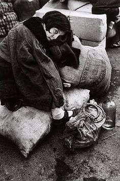 Young girl at refugee transit center, Barcelona, Spain. Jan. 15-1939 - Robert Capa