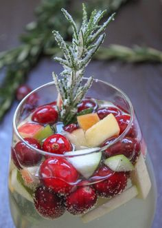 31 Amazing Holiday Cocktail Recipes Cranberry Rosemary White Christmas Sangria on Cooking Stoned TV plus 31 Amazing Christmas Cocktails on Frugal Coupon Living. Winter Cocktails, Christmas Cocktails, Holiday Cocktails, Cocktail Drinks, White Christmas Sangria Recipe, Sangria Drink, Holiday Parties, Sangria Recipes, Cocktail Recipes