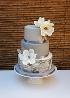 Wedding cake with marble fondant and magnolias by Florence Devouge - http://cakesdecor.com/cakes/269774-wedding-cake-with-marble-fondant-and-magnolias #weddingcakes