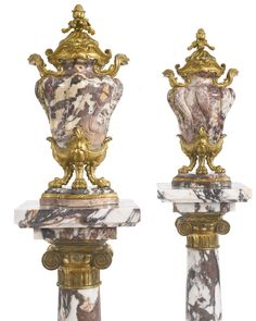François Linke  1855 - 1946  A LARGE PAIR OF GILT BRONZE MOUNTED FLEUR DE PÊCHER MARBLE URNS  Paris, early 20th century