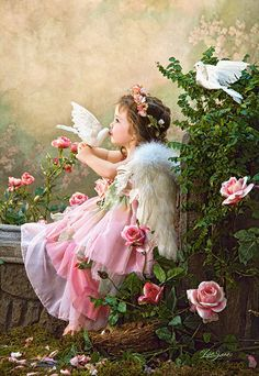 """Castorland's Angel Kisses jigsaw puzzle. Assembled size measures approximately 27""""x18.5"""""""