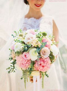 Imitate a 'freshly picked from the garden' look into your wedding bouquet by pairing lush blooms with smaller varieties of flowers and sprigs of greenery.