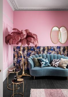 Pink wall feather palm leaf ornament and teal velvet sofa - House of Fraser