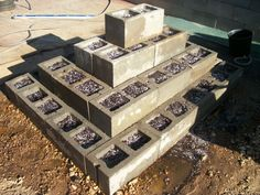Strawberry Pyramid. Build a pyramid planter for your strawberries. Each hole in the concrete block will hold more than enough soil for a strawberry plant. Wooden pyramid options I've seen waste too much soil under unused space. Once the plants grow in you will have a nice strawberry terrace effect. If you just make a border of blocks and don't terrace out the center, fill it with soil to plant some herbs or veggies. - Love it! This is the closest I have seen to what I want!