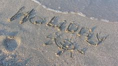Holiday And Sun Smiley In Beach Sand (3 clips)