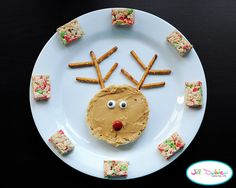 from meet the dubiens blog      Reindeer: Half a toasted english muffin with peanut butter. Candy eyes and M+M nose. Pretzel antlers. I cut up a holiday rice krispie treat to add around the plate.