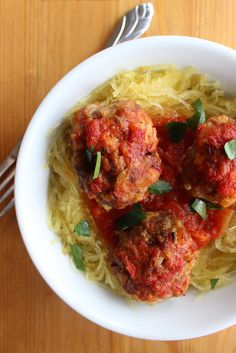 Paleo Meatballs and Spaghetti Squash - The Paleo Comfort Meal You'll Be Craving All Winter - Even if you follow a Paleo lifestyle, you can still get all the comfort of a big bowl of spaghetti (squash) and meatballs. This version is much lower in carbs, and almond flour stands in for classic breadcrumbs to hold the meatballs together.