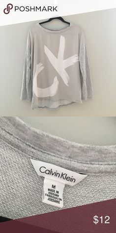 Calvin Klein 3/4 Sleeve T Shirt Calvin Klein 3/4 Sleeve T Shirt, only worn once. Like new. Sleeves are not full length. There are snaps for the option to roll sleeves up. Calvin Klein Tops Tees - Long Sleeve