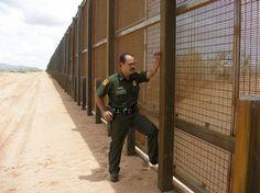 U.S. Border Patrol Agent Martin Hernandez stands at the 18-foot tall partition at the Santa Teresa port of entry in New Mexico. — in Santa Teresa, New Mexico.