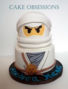 "Lego Ninjago - Two tier cake; 8"" & 6"" with Wilton half ball..."