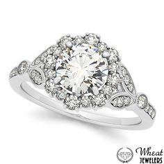 Round Floral Pattern Engagement Ring with Leaf Side Detail available at Wheat Jewelers