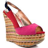 Keep it playful and lively in the Delve from 2 Lips.  A multi color fabric upper consists of 3 different vibrant colors and a slingback adjustable strap.  A woven rainbow 4 3/4 inch wedge and 1 inch platform completes the cheery peep toe.