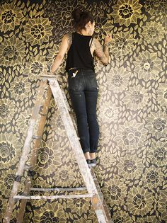 gold paint pen on black walls, Marilyn Rondon.