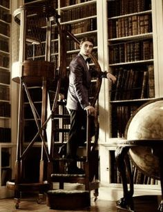 Max Irons in the library at Althorp