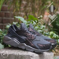 da9f4064828b The upper of this Nike Air Huarache is colored in a dope anthracite  colorway with a