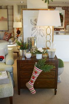 Fill your stockings with greenery and red berries for the holiday season! // Kellogg Collection