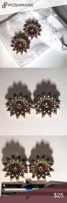 Vintage Sunburst Crystal Clip On Earrings  Gorgeous Vintage Earrings Beautiful Sunburst Style Earrings, each Hand crafted with dazzling Purple Crystals and Turquoise Cabochons.  Their Story:  These were Rescued by Me from a Sweet Elderly woman who loved her Costume jewelry, her family issued an Estate Sale on her things (so sad)  and I bought EVERY piece of her Dazzling Collection.  It's my privilege to love and enjoy it as she would've wanted, and share it with you all who'll appreciate…
