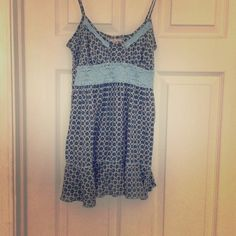 Flowy free people tank top. Fun pattern! This is a Flowy top by free people. Size 2 but fits like a small/medium. Fun knit/crotchet detail. Older to so it has been gently loved. Only noticeable thing is that one of the straps broke so I got it sewn back on (can see in last picture. ) Free People Tops Tank Tops