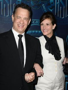 Pin for Later: See Julia Roberts's Smiliest Moments  Julia and her Larry Crowne costar Tom Hanks smiled for the cameras at an awards ceremony in February.