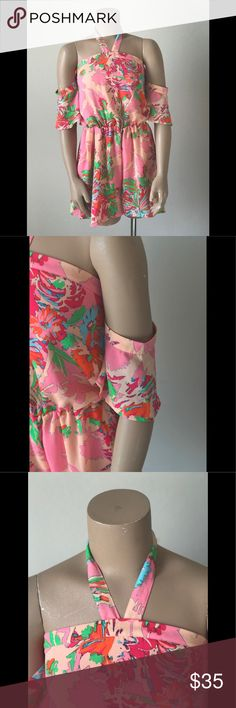 GB Cherry Blossom Romper This Halter Romper has attached short sleeves. It also has an elastic waist for a blouson effect and has pockets.  It would look best with cute sandals. Gianni Bini Shorts