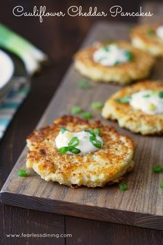 Gluten free cauliflower pancakes make a wonderful appetizer, side dish, or vegetarian meal. Crispy on the outsides and cheesy tender on the inside, you will love this easy riced cauliflower recipe.