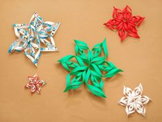 Three dimensional paper snowflakes look beautiful hanging in a window or on a wall. Fun for kids or adults, they are easy to make. Some like them for Christmas, but you may like them any time! Gather materials. You'll need six (or eight...