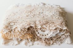 A mishmash of 60 doilies in all shapes and sizes used for table decor.  Took me 6 months to gather them all, so I would rather sell 100 of them one lot.  Perf